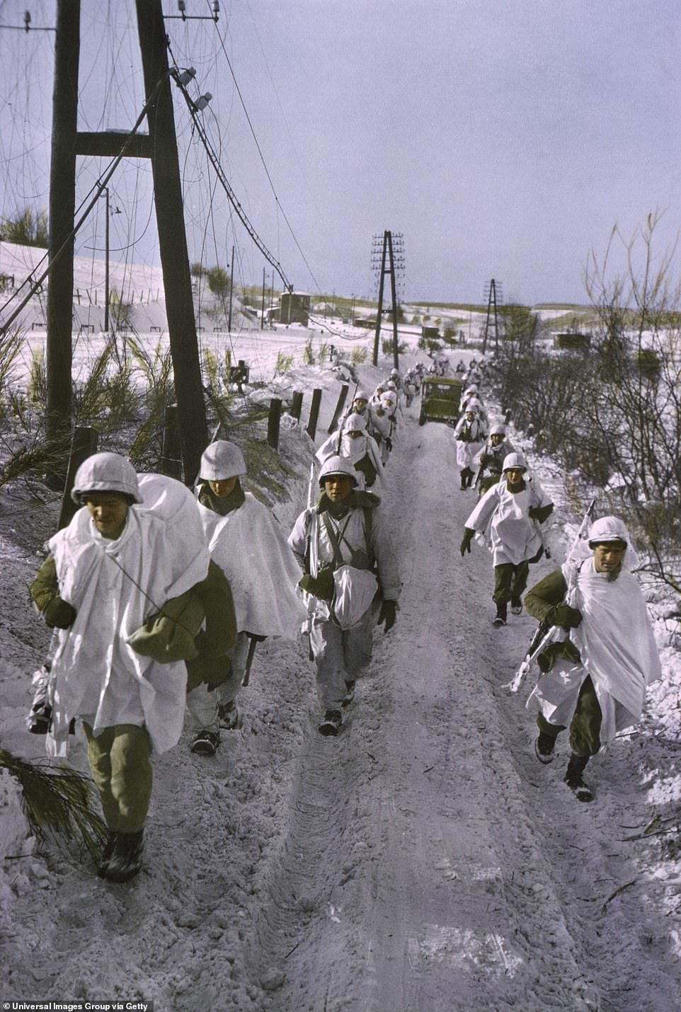 190-8176637-Soldiers_march_down_a_snowy_track_running_through_the_western_fr-a-120_1585754588777.jpg